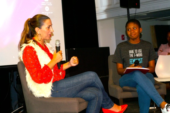 My student, Genevieve, interviews Rachel Lloyd, founder and director of GEMS, about her memoir Girls Like Us at our 2011 annual  GEMS assembly (photo courtesy, Laura Hahn).